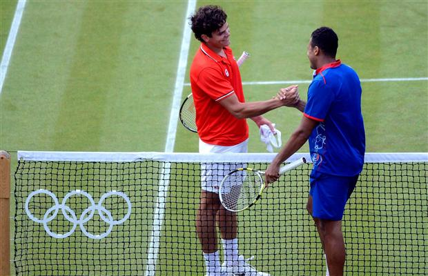 Raonic and Tsonga shake hands after setting a record for the longest third set ever at the Olympics.