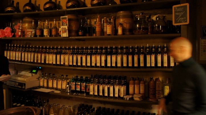Hans among the many (antique) bottles at Wynand Fockink.