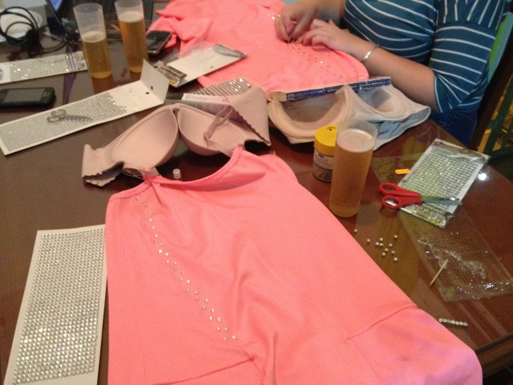 Beer and bedazzling our teeny salsa dresses. A party, really.